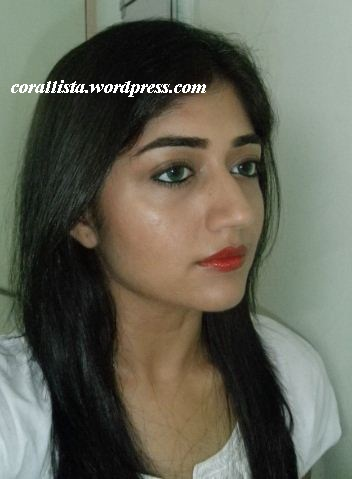 Heavy kohl lines eyes with red lips makeup look